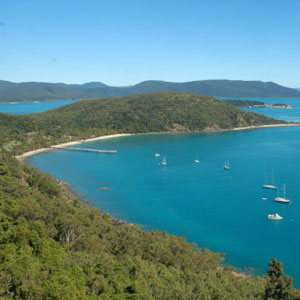 View across the turquoise waters and green hills of Bauer Bay on South Molle Island in the Whitsundays