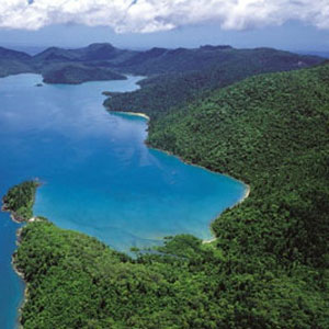 Aerial view over Cid Harbour and the surrounding lush hills of Whitsunday Island